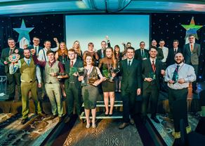 Winners and runners-up on stage at Lantra Scotland's Land-based and Aquaculture Learner of the Year Awards.jpg
